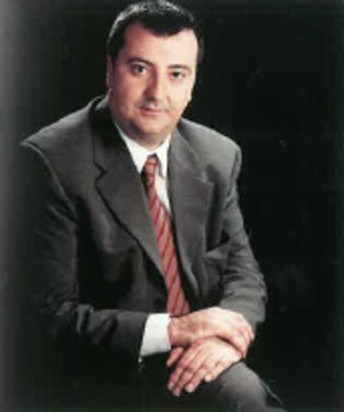 Sr. Enrique A. Luque Muñoz
